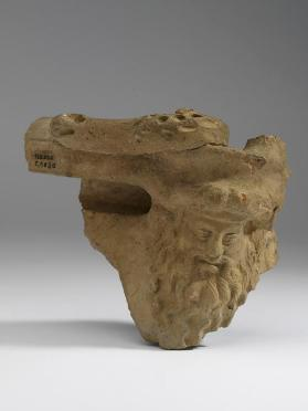 Situla fragment with Bacchus head handle-attachment