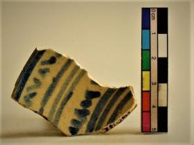 Blue and White on White cup fragment (rim sherd)