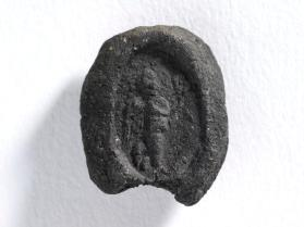 Seal impression with a winged Nike holding a wreath in both hands