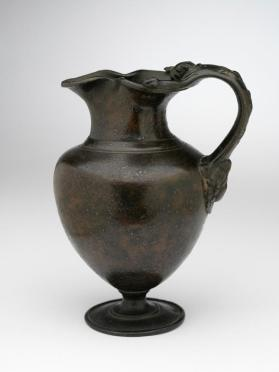 Jug with lion's head relief on handle