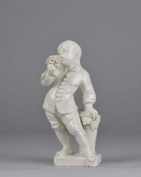 Boy with Grapes figurine