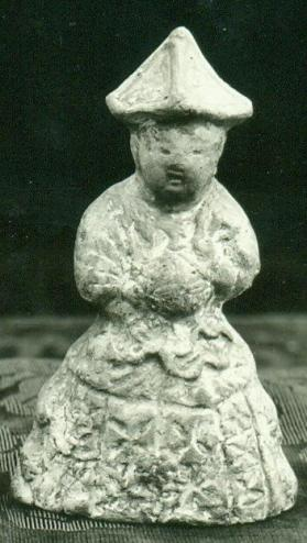 Reproduction figure of a seated male