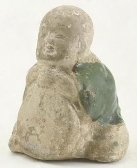 Figure of a boy with a drum