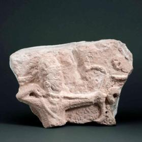 Relief sculpture with archer with drawn bow (fragment)