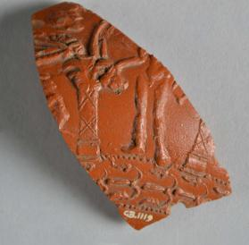 Samian ware bowl fragment with Bacchus standing
