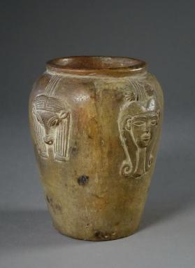 Jar decorated with four modlelled Hathor heads