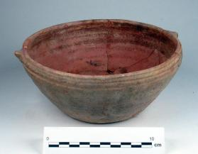 Bowl with lug handles decorated with exterior grooves under rim