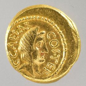 Aureus struck for Julius Caesar by Praetor A. Hirtius with head of Vesta (obverse) and priestly equipment (reverse)