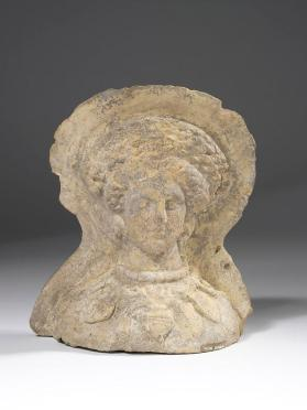 Votive head of a woman wearing jewellery