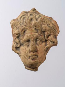 Head fragment of figure of female with snake-like hair