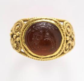 Filigree ring engraved with a satyr and a goat