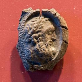 Seal impression with head of Herakles