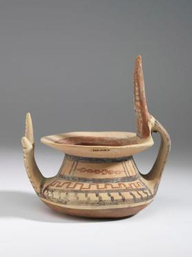 Daunian jar with attached hand and horns