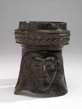 Etruscan bucchero neck of a jug showing a male mask