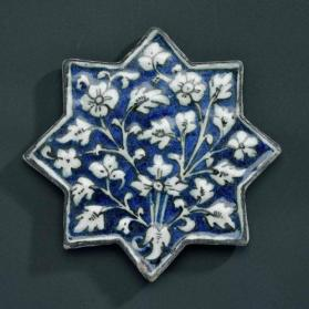 Underglaze-painted tile in star form