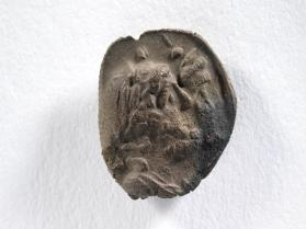 Seal impression of laureate Sarapis and Isis wearing a diadem