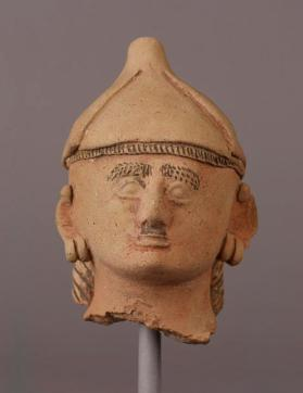 Head from a fragmentary votive figure