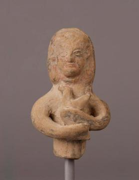 Fragment of a votive figure carrying a bird