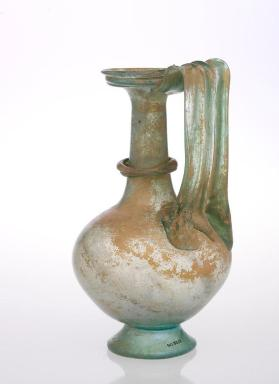 Flagon with heavy strap handle and hollow foot