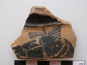 Fragment from the neck of a Klazomenian East Greek neck-amphora decorated in black figure technique with a horse's head.