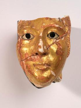 Gilt mummy mask of a woman