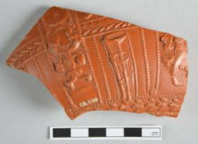 "Fragment of Samian ware bowl with large ""candelabra"" motif, dolphins at the base"