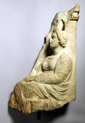 Fragment of a grave stele with a seated woman