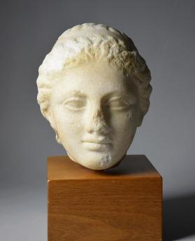 Fragmentary head of a young girl, likely from a grave stele