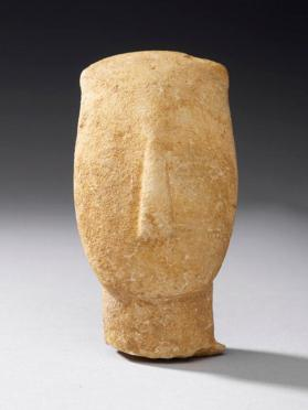 Fragmentary female figure with painted outline of eyes