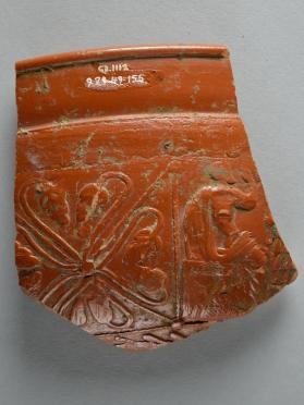 Fragment of a Samian ware vessel with seated and draped male figure