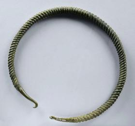Torc with four line spiral