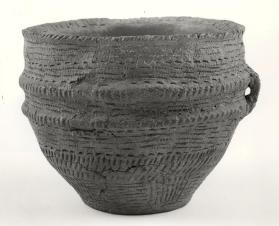 Ridged bowl with three handles