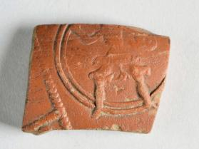 Fragment of a Samian ware bowl decorated with the figure of a warrior