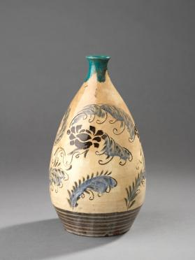Sake bottle with design of peonies and feather-like grasses
