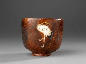 Raku type small tea bowl with standing crane