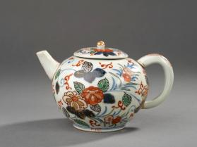 Round tea pot with polychrome floral decoration