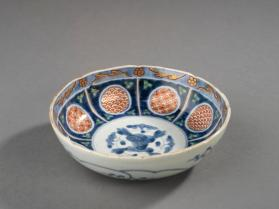Small deep dish with polychrome floral and geometric designs