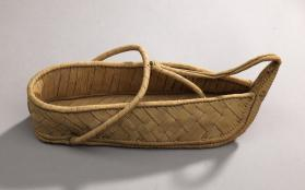 Pair of woven palm frond open shoes