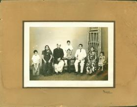 Photograph of two seated families