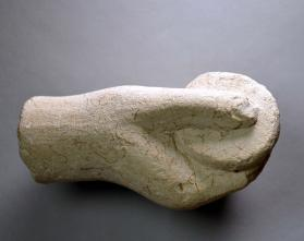 Hand of votive figure, holding a cylindrical container or pyxis