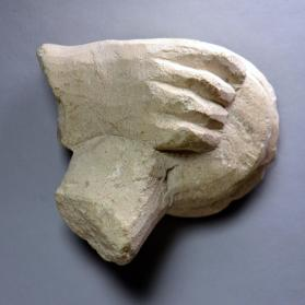 Hand from a votive figure, holding a phiale (bowl)