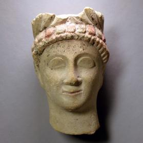 Head from a fragmentary male votive figure