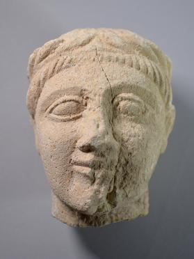 Head from a fragmentary votive figure wearing a wreath