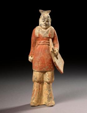 Burial figure of a military attendant with a shield