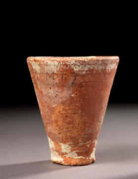 Cup with traces of gypsum from foundation deposit