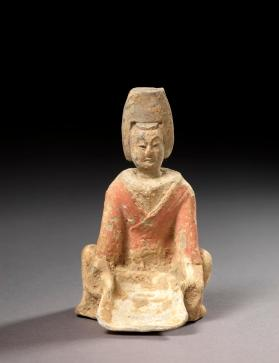 Burial figure of a female servant with a winnowing basket