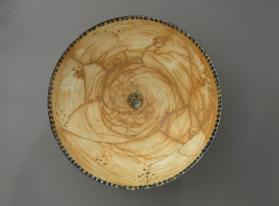 Bowl with fenestrated design