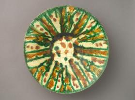 Bowl with incised and `splash`-painted design