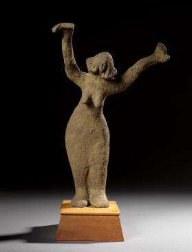 Figure of standing female with upraised arms