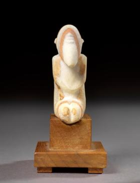 Figure of seated bearded man